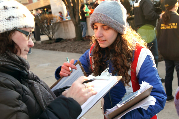 Rachel English, with Grass Roots Organizing, gathers signatures in Columbia.